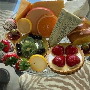 Fake fruit tarts, cheeses, strawberries, bread etc